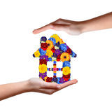 House symbol from flowers in hands Stock Image