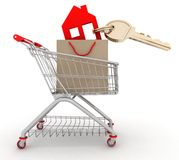 House symbol with key in a paper shopping bag and shopping cart Royalty Free Stock Image