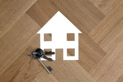 House symbol with keys on wooden floor royalty free stock photos