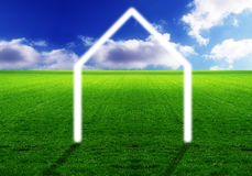 House symbol in the meadow. A house symbol in an undeveloped area symbolizing an investment Stock Photography