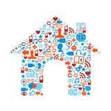 House symbol with media icons texture. Social media icons set in house symbol shape composition Royalty Free Stock Image