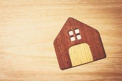 House symbol on wood floor. Background Stock Photography
