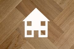 House symbol on wooden floor stock photo
