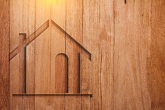 House symbol on wooden plank background stock images