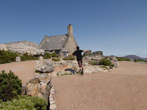 House on Table Mountain. House on summit of Table Mountain with person running in foreground, South Africa Royalty Free Stock Image
