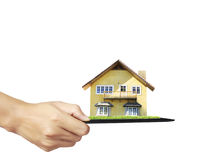 House on tablet in hands Royalty Free Stock Photo