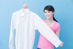 Housewife take clean shirt. House take clean shirt on the blue background royalty free stock photo