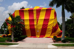 House tented for fumigation. A house is tented with bright vinyl covers prior to a pest control fumigation Royalty Free Stock Image