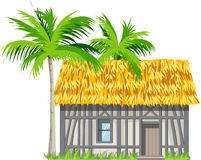 A house with a thatched roof and palm trees Stock Photos