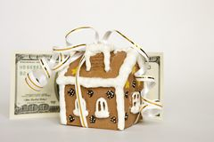 House tied with ribbon and money Royalty Free Stock Image