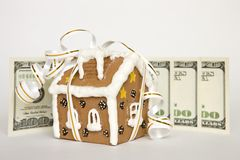 House tied with ribbon and money Royalty Free Stock Images