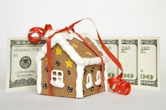 House tied with ribbon and money Royalty Free Stock Photography