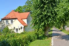 The house with a tile roof on Sovetskaya Street in the summer afternoon. Settlement Amber, Kaliningrad region.  Royalty Free Stock Photography