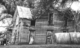 The House that Time Did Not Forget. Black and white shot of a very old wooden houe with a tin roof that time has taken a serious toll on. Besides several areas Stock Photography