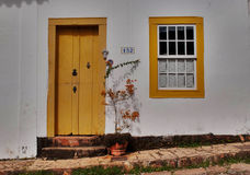 House in Tiradentes, Brazil. Houses have colourful doors and windows ni the small and beautiful cidade historica or historic town of Tiradentes, Minas Gerais Royalty Free Stock Photo