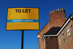 House to let. Yellow sign for house to let Stock Image