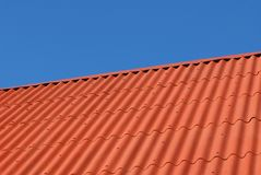House-top. Modern metal profile roof and  dark blue sky Stock Photos