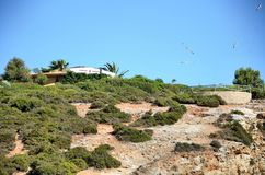 House on the top of a cliff Stock Image