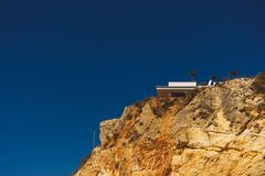 House at the top of a cliff near beach D. Ana Lagos Portugal stock photo