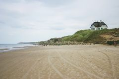 A house on top the dunes with a epic view to the beach royalty free stock photos