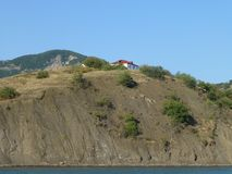 House on top of a hill stock photography