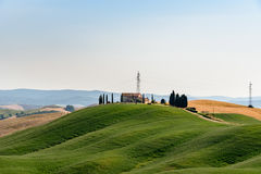 A house at the top of a hill near Siena. A house at the top of a hill in the Crete Senesi royalty free stock images