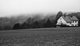 House on top of a mountain. A house on top of a mountain on a foogy morning Royalty Free Stock Photos