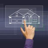 House on touchscreen. Hand press a house model on touchscreen Royalty Free Stock Photos