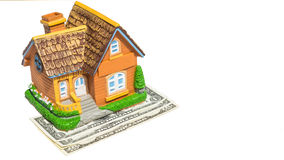 House toy on money bank notes Stock Photos