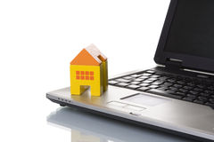 House toy over a laptop Stock Image