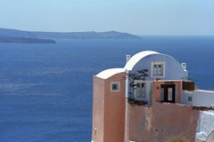 House in traditional Cycladic architectural style, on the edge of the volcano caldera of Santorini island. Stock Photos
