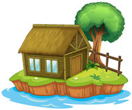 A house and tree on island Stock Photo