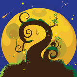 House on a tree under the moon Stock Photo