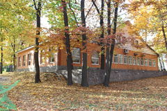 House through the trees. Autumn. house through the trees in the park royalty free stock image
