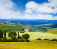 House, trees and background of Tuscany landscape Stock Image