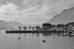 House and trees in Brienz, Switzerland. Lake Brienzersee and mou. Scene in Brienz, Switzerland. Lake Brienzersee and mount Augstmatthorn. Quai Royalty Free Stock Photos