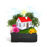 House, trees and green grass in travel bag Royalty Free Stock Photo