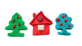 House and trees from plasticine Royalty Free Stock Images