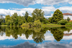 House and trees reflection on water. House and trees reflection by the lake Stock Photography