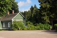 House among the trees. Small house in the forest in sunny weather Stock Photography