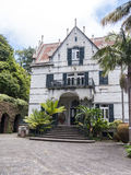 House in Tropical Garden at Monte above Funchal Madeira. This wonderful garden is at the top of the cablecar from the seafront in Funchal. It is filled with Stock Photos