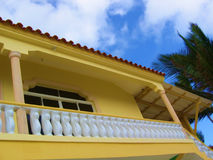 House - Tropical and Yellow. A yellow tropical house with bright white architectural detail taken in Punta Cana, Domican Republic stock photography