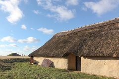 House and tumulus from Bronze age period in Borum Eshoj, Denmark. House and tumulus from Bronze age period, Borum Eshoj, Denmark Stock Photos