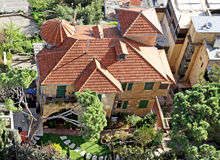 House with turrets under a tiled roof. HAIFA, ISRAEL - FEBRUAR 29, 2016: Top view of a house with turrets under a tiled roof Stock Photography