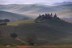 House in Tuscany in the morning fog Royalty Free Stock Photography