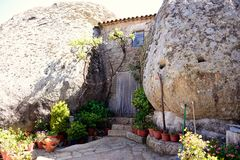 House between two boulders Stock Images