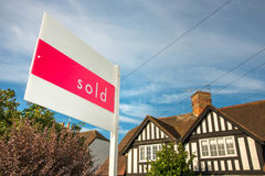 House in UK with sold sign. Estate agency sold sign for a traditional English property. UK real estate market is a prosper business, a huge bubble that could pop stock image