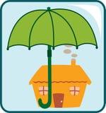 House and Umbrella Stock Photos