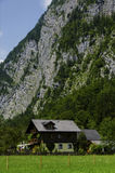 House under the alps cliff Stock Photography