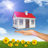 House under businesswomans hand Stock Images